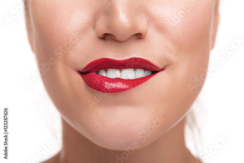 Sensuous woman biting red lips. Poster