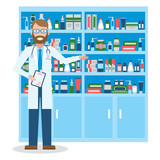 Pharmacist in drug store. Handsome smiling doctor in white standing near shelf with medication.