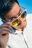 Portrait of stylish man looking over glasses