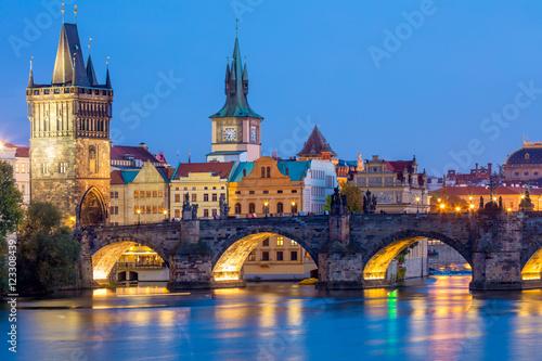 Poster Praag Famous Prague Landmarks - towers and bridge at night