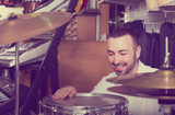 Male buyer selecting drums