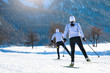 Couple man and woman cross-country skiers with skating technique