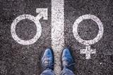 Legs with gender symbol on asphalt, gender concept - 123326074