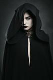 Beautiful vampire woman with black cloak