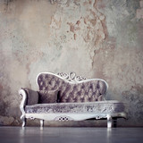 Fototapety Grunge Styled Interior. Beautiful sofa in classical style on a background of textured walls