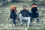 halloween man and girls with pumpkin