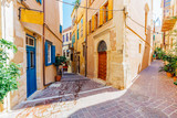 Venetian architecture in narrow stone streets of old town Chania in Crete, Greece
