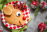 Christmas food for kid. Rudolph reindeer pancake