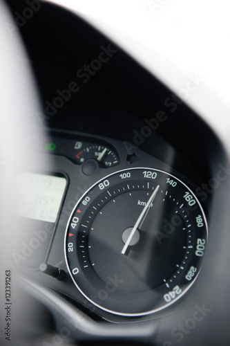 Poster Car speedometer close-up with the needle pointing a high 130 km/mph speed, blur