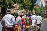 Balinese monk and worshipper at the temple for full moon celebration