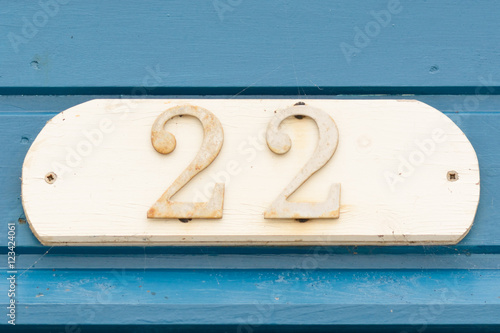 Poster House Number 22 sign on door