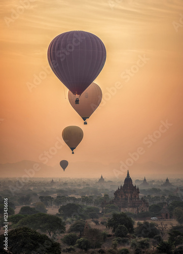 Hot air balloon over plain of Bagan in misty morning, Myanmar Poster