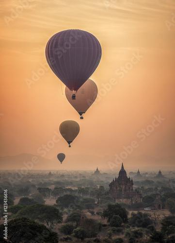 Hot air balloon over plain of Bagan in misty morning, Myanmar