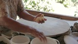 Female hand rolled dough cake