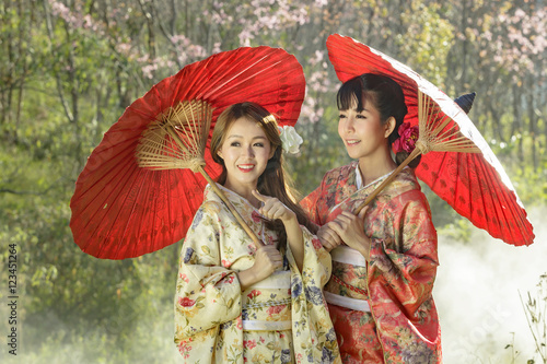 Poster Couple asian women wearing traditional japanese kimono and red u