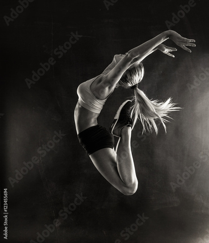 Fitness female woman with muscular body jumping . - 123455694