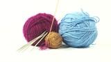 Balls of woolen threads. A thread unwinds from a ball. 4K