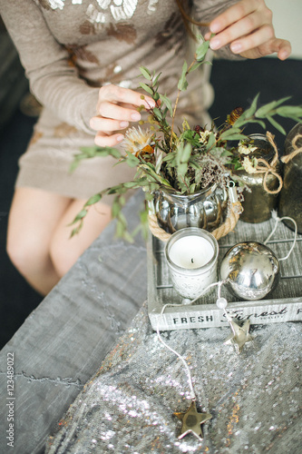 Poster Florist female works with flowers decoration on wooden table