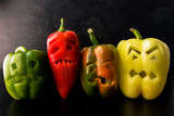 Halloween theme. Halloween peppers with scary faces.