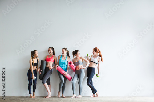 Smiling women in fitness studio. © BestForYou