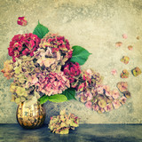 Hortensia flowers bouquet stone background vintage toned