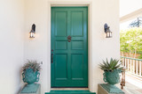 Green entry door with door knock. - 123506004