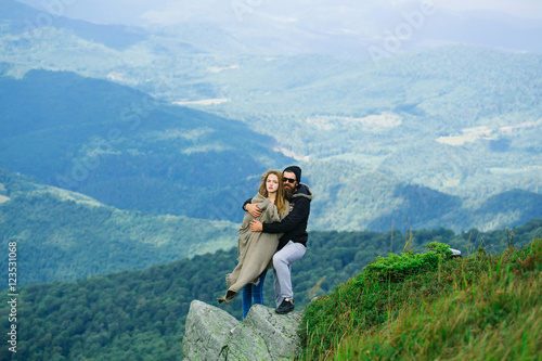 Poster Romantic couple on mountain top