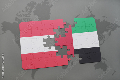 puzzle with the national flag of austria and united arab emirates on a world map background.