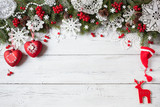 Christmas wooden  white  background  with  snowflakes, tree branches and red berry