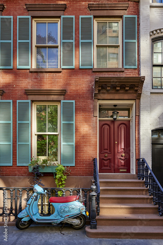Foto op Canvas Scooter a brownstone building with a scooter