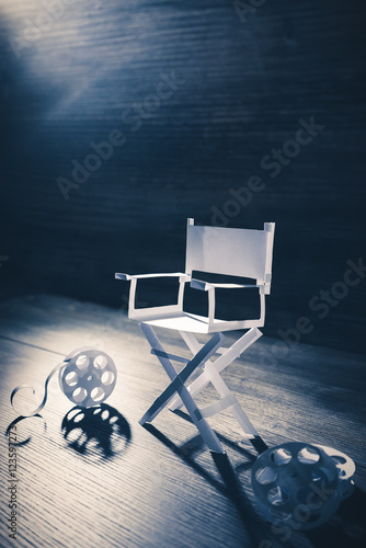 Poster paper director chair on a blueish grey background