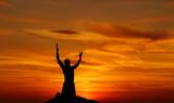 Dramatic sky scenery worshiper praying with despair - 123606661