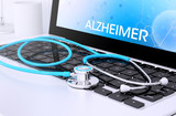 stethoscope on laptop keyboard with screen showing alzheimer