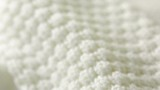 white knitted wool texture. use as background. close-up