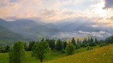 Time Lapse. Mountain Landscape. Sun Rays Pass through the Clouds Over the Mountains at Sunset. 4K.