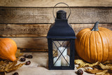 Halloween lantern and pumpkin on old wooden table