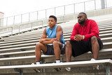 Fototapety Coach spending time mentoring a student athlete.