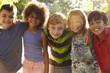 Portrait Of Five Children Having Fun Outdoors Together