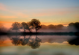 Stunning vibrant Autumn foggy sunrise English countryside landsc