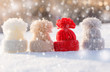 Woolen knitted hats on snow. Hello winter! Holiday background