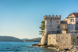 Korcula old town tower. / Scenic view at old town Korcula tower and walls, Adriatic sea, Croatia. - 123718630