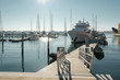Sparkling sun covers with daylights a berth with white yachts