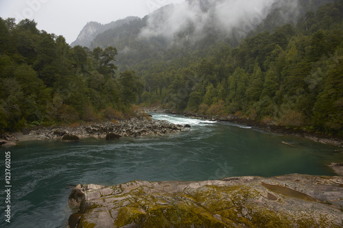Aluminium Rio de Janeiro River Futaleufu flowing through mist shrouded forests in the Aysen Region of southern Chile. The river is renowned as one of the premier locations in the world for white water rafting.