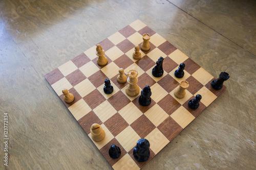 Plakát, Obraz Chess board wooden table check mate