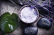 Quadro Wellness of body and soul with lavender, spa salt, stones and a green leaf