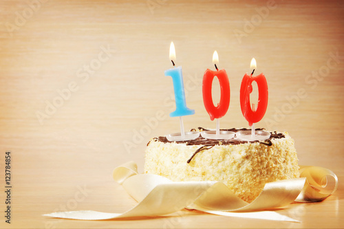 Poster Birthday cake with burning candle as a number one hundred