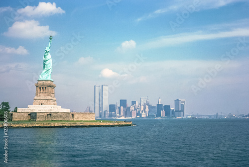 Foto op Aluminium New York Statue of Liberty and Twin Towers, destroyed in September 11, 2001, of World Trade Center. New York City skyline view from the ferry boat. Symbols NYC, United States.
