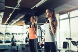 Fototapety Women working out in gym