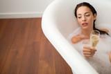 Beautiful woman enjoying bath