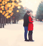 Silhouette of loving couple embracing in warm winter day, christ